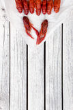 Boiled crawfish. Woden background. Rustic style. Seafood menu. Stock Photos