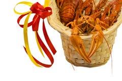 Boiled crayfish in basket. Tasty fresh boiled crawfish. Men`s holiday gift. royalty free stock image