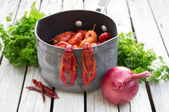 Boiled crayfish. Woden background. Rustic style. Seafood menu. Royalty Free Stock Photography