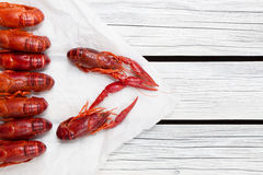 Boiled crayfish. Woden background. Rustic style. Seafood menu. Royalty Free Stock Image