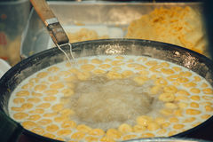 Boiled dessert in boiling syrup shallow DOF stock photo