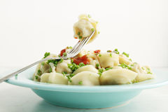 Boiled dumplings on a fork Stock Image