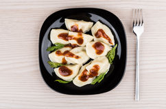 Boiled dumplings in plate and fork on table, top view Royalty Free Stock Photography