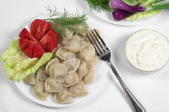 Boiled dumplings with sour cream Royalty Free Stock Images