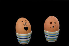 Boiled Egg. The picture shows an egg with cracks in its shell and an egg which is scared about that stock photos