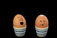 Boiled Egg. The picture shows an egg which shell is partial missing and an egg which is scared about that Stock Image