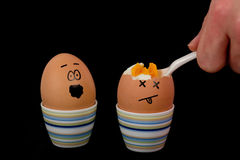 Boiled Egg. The picture shows an egg being eaten and an egg which is scared about that stock image
