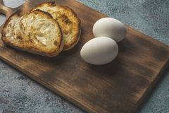 Boiled egg on with bread wooden background stock image
