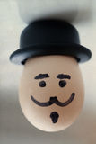 Boiled egg character. Egg with a human face. (retro style, old paper background, soft focus) Stock Photo