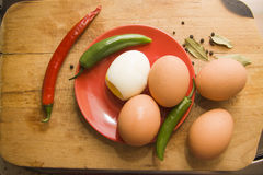 Boiled egg and chili pepper Stock Image