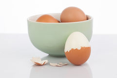 Boiled egg and a clay bowl of eggs Royalty Free Stock Image