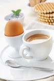 Boiled egg and coffee for breakfast Royalty Free Stock Images