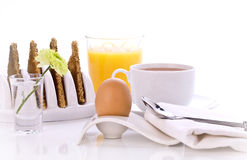 A boiled egg, coffee and orange juice Stock Images