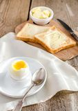 Boiled egg with crispy toasts on the wooden table Royalty Free Stock Image