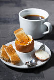 Boiled egg, cup of coffee and crispy bread, vertical Royalty Free Stock Photo