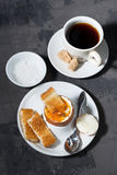Boiled egg, cup of coffee and crispy bread, vertical, top view Royalty Free Stock Photos