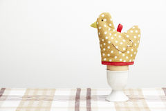 Boiled egg in cup with hen egg warmer Stock Photography
