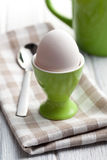 Boiled egg in eggcup Stock Image