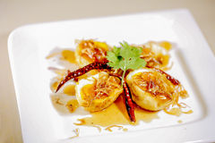 Boiled egg fried with tamarind sauce Royalty Free Stock Photos