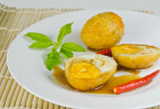 Boiled egg fried with tamarind sauce Stock Image