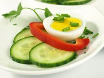 Boiled egg with garnish, close-up. Royalty Free Stock Photos