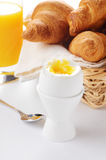 Boiled egg, orange juice croissants Stock Photography
