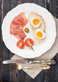 Boiled egg and parma ham tomato and olives Royalty Free Stock Photo