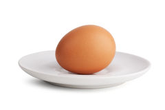 Boiled egg in a porcelain dish Stock Photos