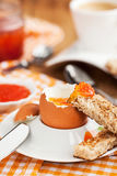 Boiled egg with red caviar, toast and coffee stock photos
