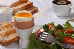 Boiled egg, salad, toast and coffee. Stock Photography