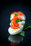 Boiled egg with salty salmon Stock Images