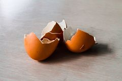 .Boiled egg shells placed on a wooden table royalty free stock image