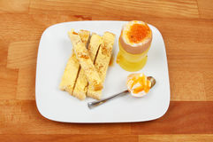 Boiled egg and toast Stock Photos