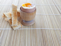 Boiled egg and toast soldiers. A boiled egg with some toast to dip into the lovely fresh yolk Royalty Free Stock Photo