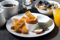 Boiled egg, toasts and coffee for breakfast Royalty Free Stock Photo