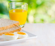 Boiled egg, toasts and orange juice Stock Photo