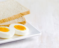 Boiled egg and toasts on white plate Royalty Free Stock Images