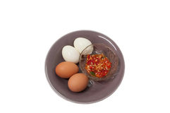 Boiled egg whit Chilli and fish sauce. In white background Royalty Free Stock Photography