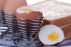 Boiled eggs. And bread, one with the top cut off stock photos