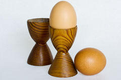 Boiled eggs. Two boiled eggs in wooden eggcups Royalty Free Stock Photos