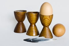 Boiled eggs. Three eggcups and two boiled eggs Stock Image