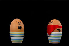 Boiled Eggs. The picture shows an egg which is attacked by another one stock photography