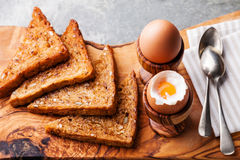 Boiled eggs for breakfast. In olive wood egg cups Royalty Free Stock Image