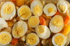 Boiled eggs and chicken in aspic Royalty Free Stock Images