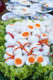 Boiled eggs cut in half with chilli put on for serve Stock Image