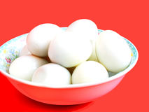Boiled eggs. A dish of boiled eggs on red isolation Royalty Free Stock Image