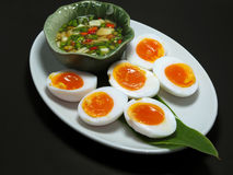 """Boiled Eggs with fish suace and chilli and garlic. Thai name is """"Khai Tom Prik Nam Pla"""", Isolated on Black Background Royalty Free Stock Photography"""