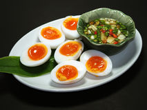 """Boiled Eggs with fish suace and chilli and garlic. Thai name is """"Khai Tom Prik Nam Pla"""", Isolated on Black Background Stock Photo"""