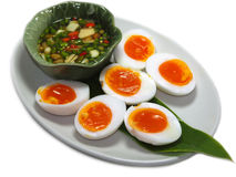 """Boiled Eggs with fish suace and chilli and garlic. Thai name is """"Khai Tom Prik Nam Pla"""", Isolated on White Background Stock Photo"""