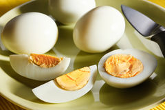 Boiled eggs on green plate Stock Images